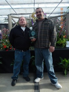 George and Dean accepting the Orchid Digest Award for the COS Show Display