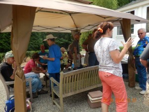 Gathering around the food and drinks table.